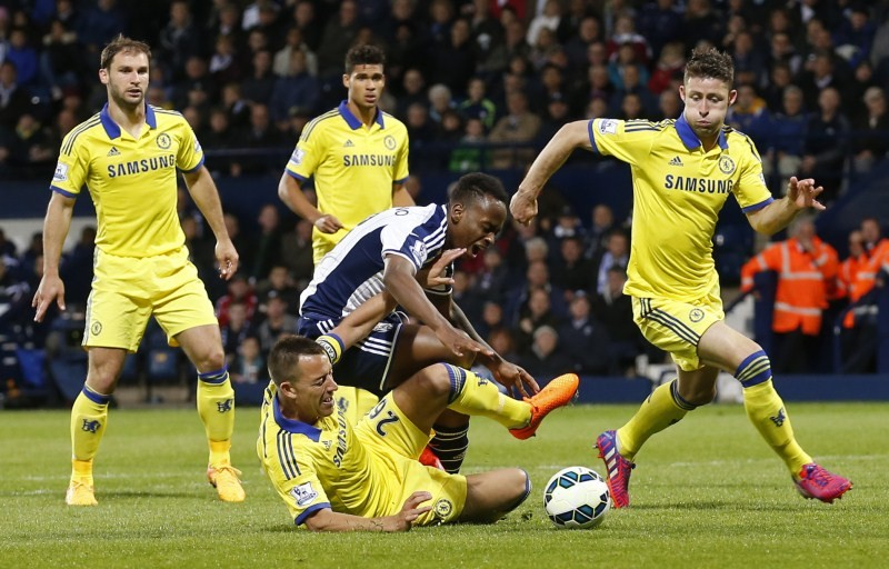 ohn Terry fouls West Brom's Saido Berahino resulting in a penalty Action