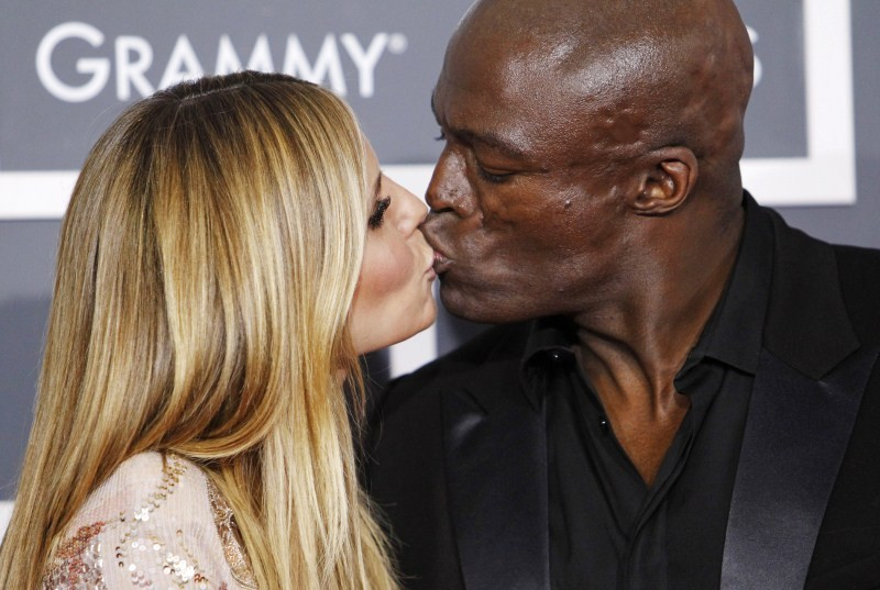 Model Heidi Klum and singer Seal kiss on the red carpet at the 52nd annual Grammy Awards in Los Angeles