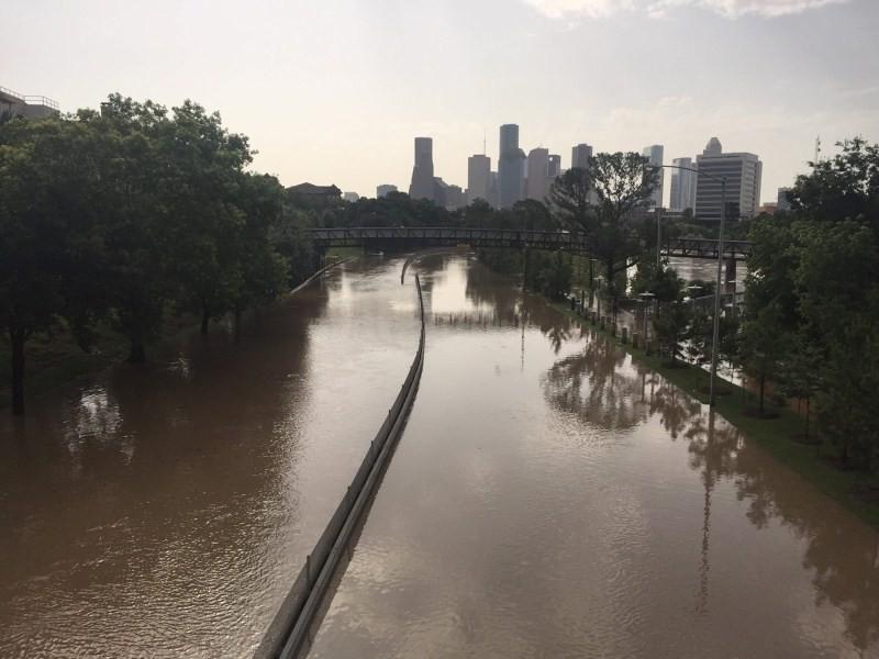 Flood waters cover Memorial Drive along Buffalo Bayou in Houston, Texas