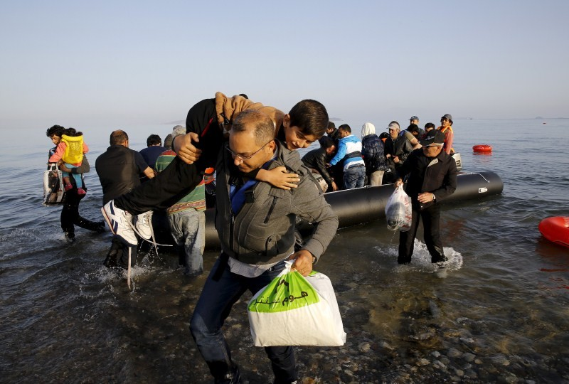 Refugees Arrive on Greek Island,Refugees on Greek Island,Refugees land on Greek island,Greek island,south-eastern Aegean Sea,Aegean Sea,Syrian,Afghan immigrants