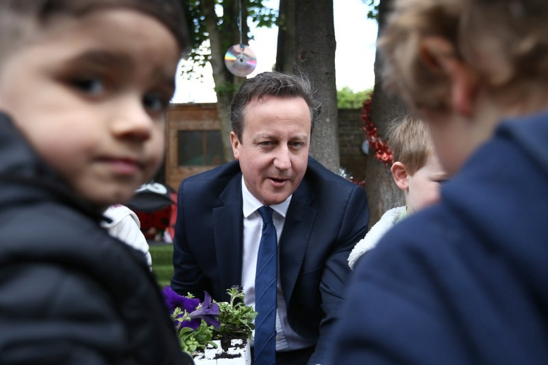 Prime Minister David Cameron plants flowers with children,Prime Minister David Cameron,David Cameron,Britain's Prime Minister David Cameron plants flowers,children's nursery,children nursery,Priti Patel