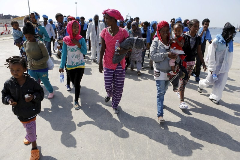 Migrants,Migrants at Sicilian harbour of Augusta,Migrants at Sicilian harbour,Sicilian harbour,Migrants wait to disembark,Sicilian harbour of August,Italy