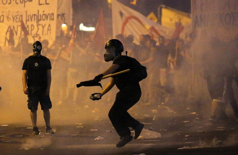 Protests Turn Violent in Greece,Protests in Greece,Anti-austerity movement in Greece,Greece protests turn violent,bailout deal,amid protests,anti-establishment protesters
