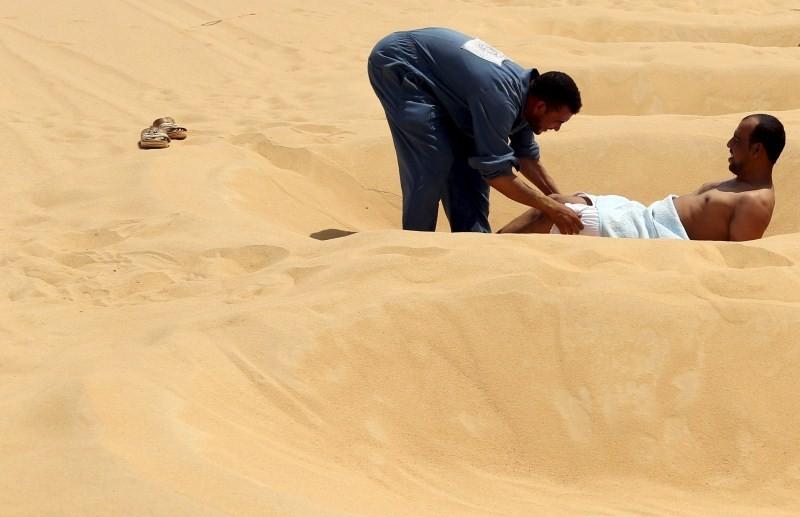Hot Sand Baths of Siwa,Hot Sand Baths,Patients Sand Baths of Siwa,desert,Patients,treatment,sand bath treatment,sand bath