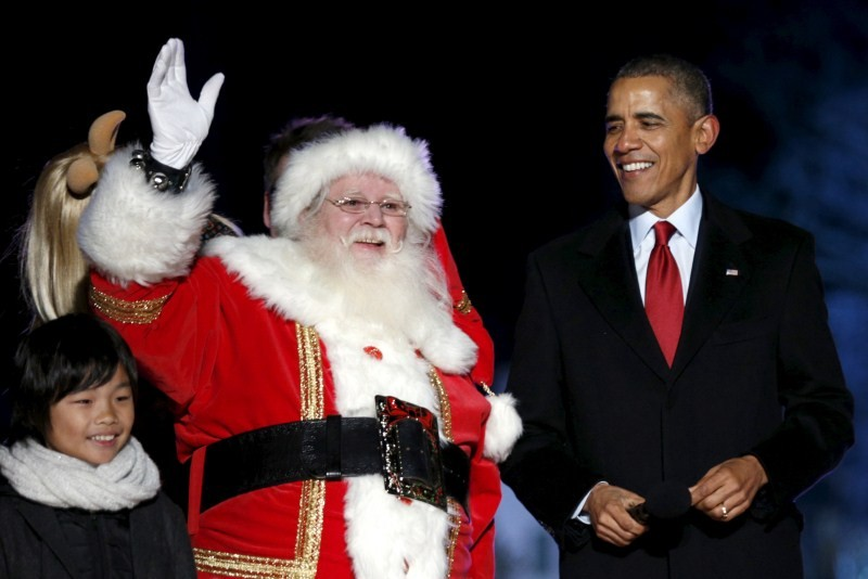 Barack Obama,Barack Obama lights Christmas tree,Obama lights Christmas tree,Obama hugs Santa Claus,Christmas Tree Lighting,Obama