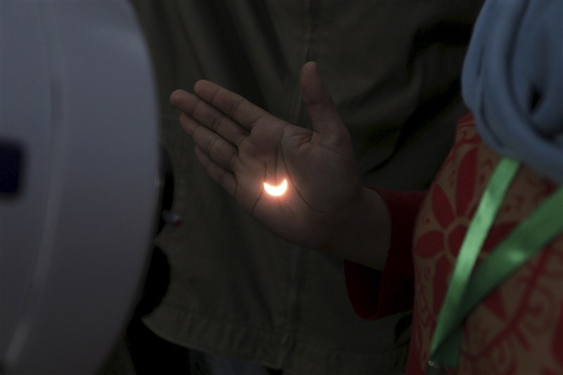 A diamond ring solar eclipse is seen from Matantimali, Palu, Central Sulawesi, Indonesia, India.