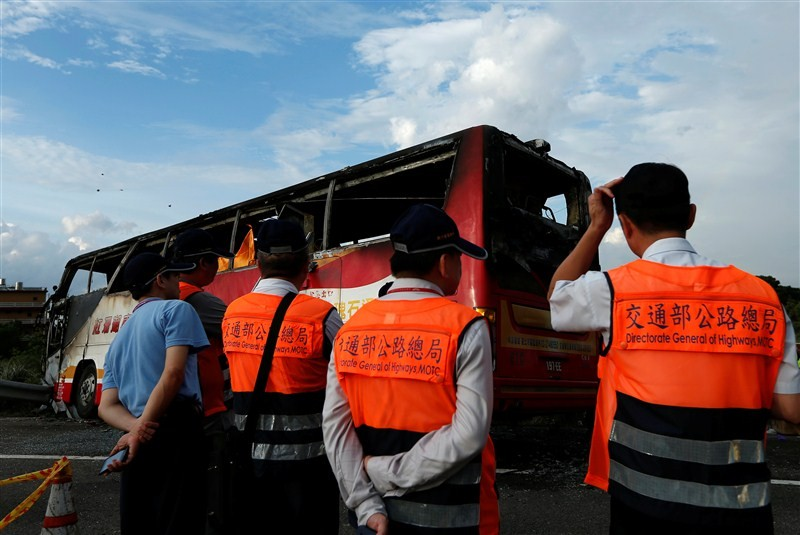 At least 26 Chinese passengers were killed on Tuesday when their bus crashed into a roadside barrier and burst into flames in Taiwan's Taoyuan municipality.