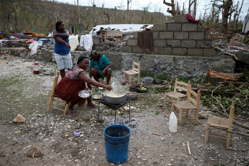 Women cook their meal in a partially destroyed school used as a shelter in Jeremie.