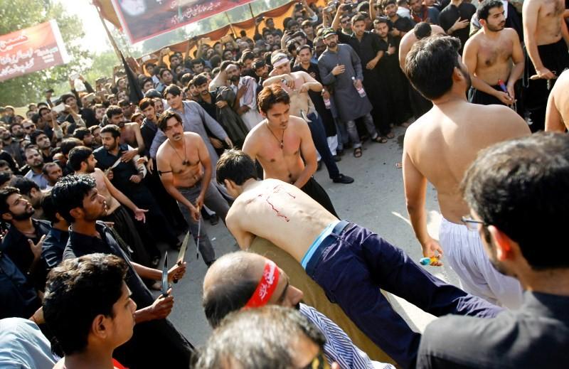Muharram,Muharram procession,Muharram procession in Peshawar,Men participate in Muharram procession,Muharram procession pics,Muharram procession images,Muharram procession photos,Muharram procession stills,Muharram procession pictures,Muharram celebration