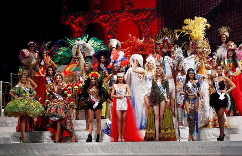 Contestants wearing national costumes pose in the opening.