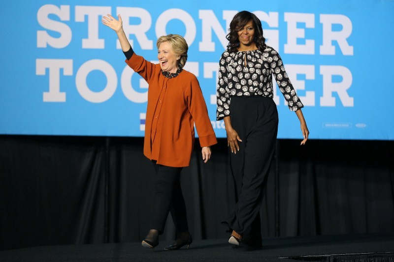 U.S. Democratic presidential candidate Hillary Clinton arrives to a campaign rally accompanied by U.S. first lady Michelle Obama in Winston-Salem, North Carolina, U.S., October 27, 2016.