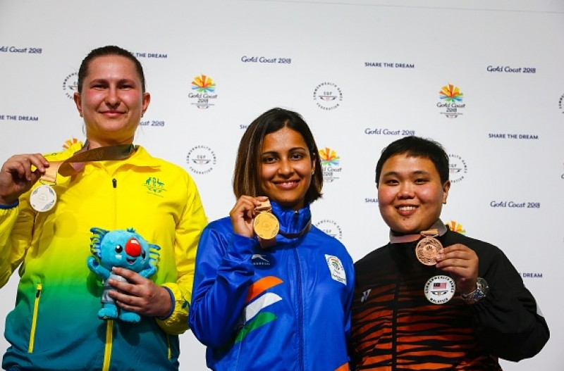 Image result for Shooter,Heena,Sidhu,wins,gold,in,women,s,25m,pistol,event,CWG,2018,