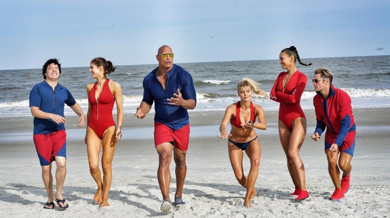 priyanka chopra sizzles in new baywatch poster as the rock sends a