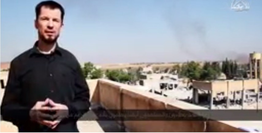 In its latest video, British journalist and ISIS prisoner reports from Kobani. The video claims that ISIS has taken over the town. Here Cantlie claims that from where he is standing he can see the Kurdish refugee camps.
