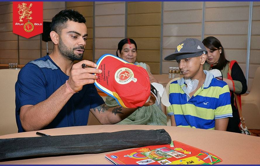 Virat kohli,virat kohli meets fan,cancer patient,virat kohli photos