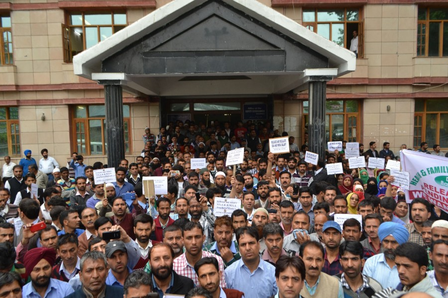 Teachers stage a demonstration to demand their pending salaries in Baramulla on 12 May 2015.