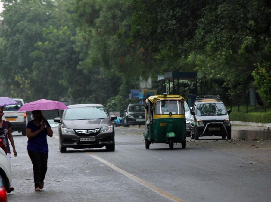 New delhi,rain in new delhi,new delhi rains,rain photos,delhi rain photos
