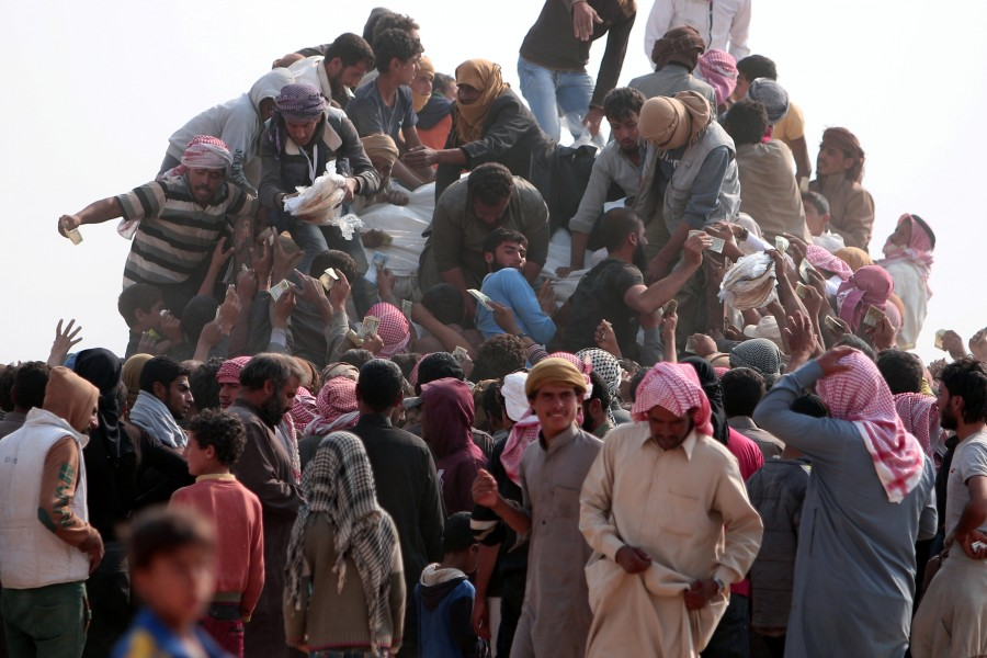 Iraqis,Islamic State,Mosul,Fleeing one war-torn country to another,refugees,Iraq refugees,Syria,northeastern Syria,Iraqi refugees
