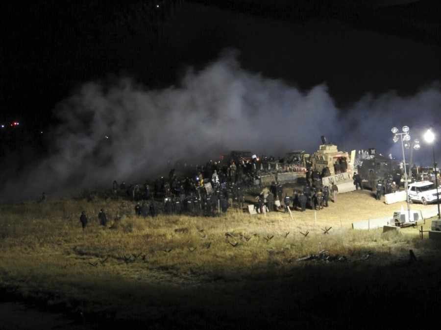 Law enforcement officers surround demonstrators protesting against plans to pass the Dakota Access pipeline during a standoff at the Backwater Bridge in Morton County, North Dakota, U.S., November 20, 2016.