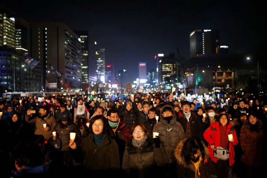 People attend a protest calling for South Korean President Park Geun-hye to step down in central Seoul, South Korea, November 30, 2016.