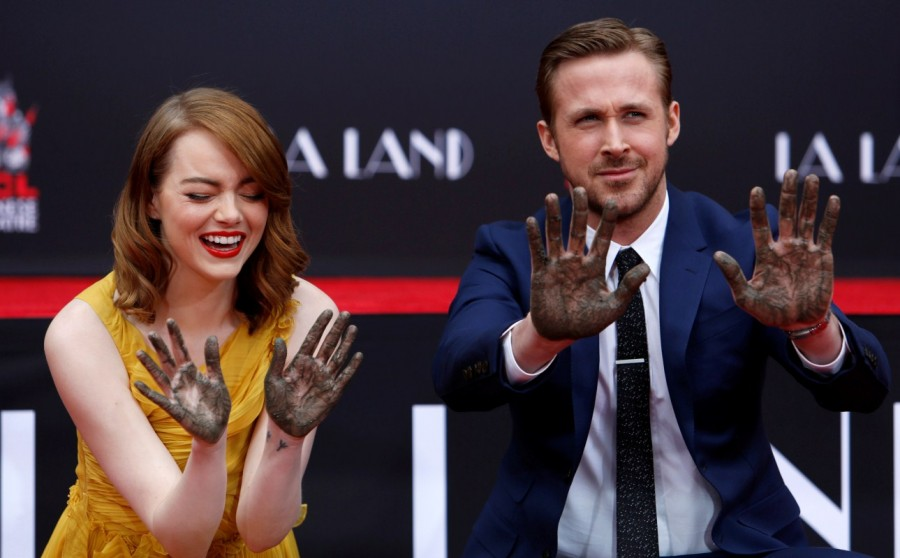 Emma Stone and Ryan Gosling,Emma Stone,Ryan Gosling,Ryan Gosling and Emma Stone cemented,TCL Chinese theatre,Chinese theatre,Ryan Gosling and Emma Stone pics,Ryan Gosling and Emma Stone images,Ryan Gosling and Emma Stone photos,Ryan Gosling and Emma Stone