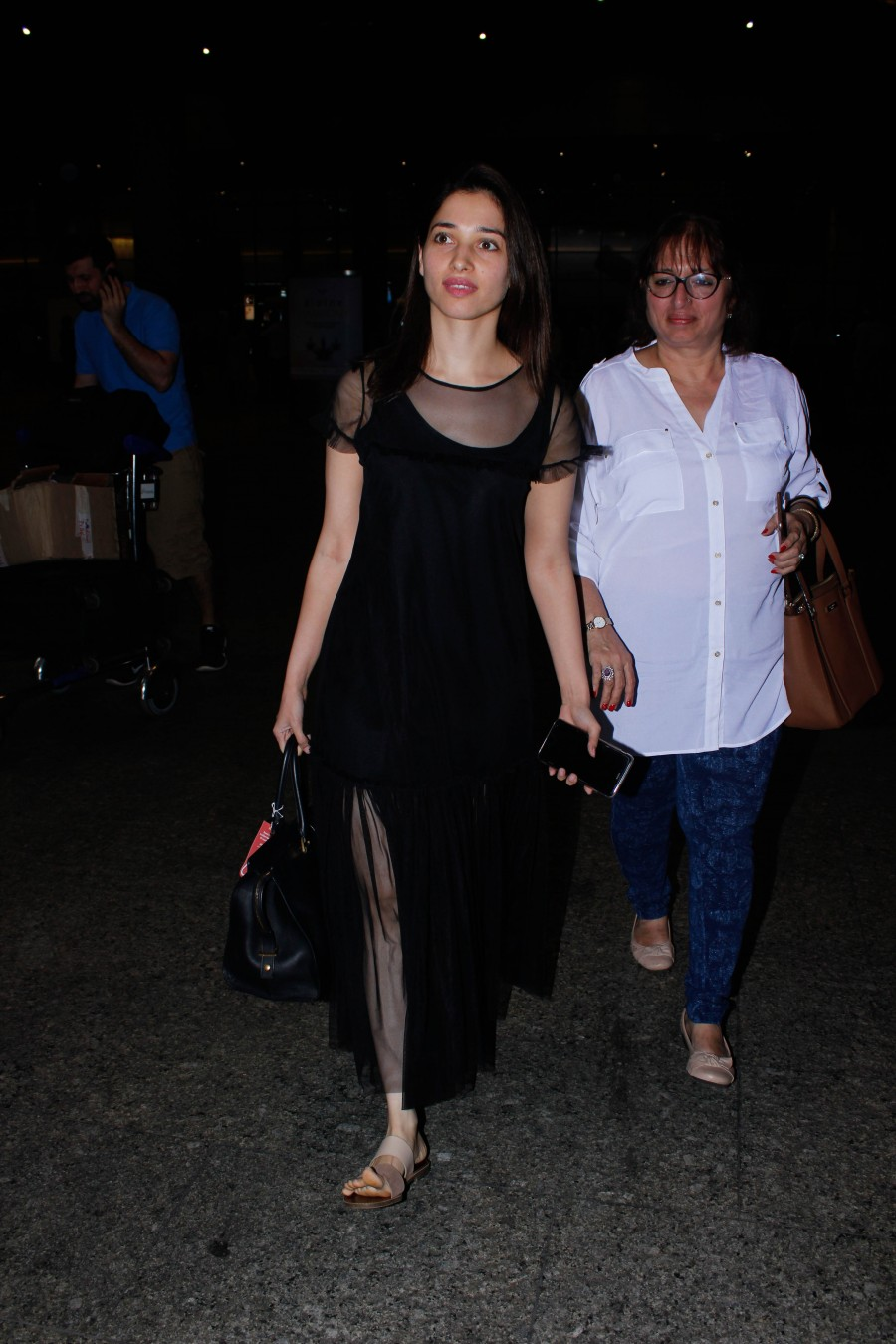 Tamannaah Bhatia,Tamannaah,actress Tamannaah Bhatia,Tamannaah spotted at Mumbai airport,Tamannaah at Mumbai airport,Tamannaah new pics,Tamannaah new images,Tamannaah new photos,Tamannaah new stills,Tamannaah new pictures