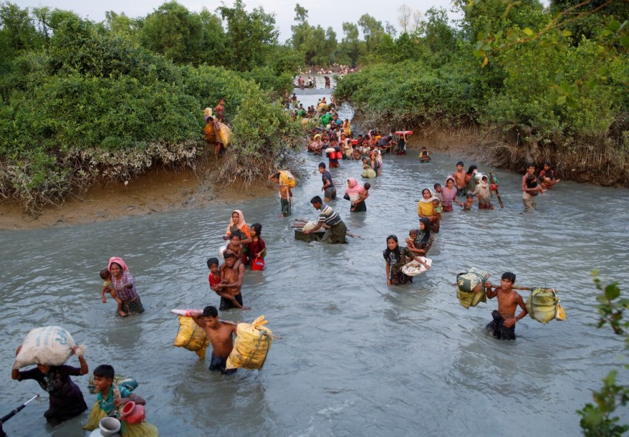 Rohingya refugees,Rohingya refugees fleeing,Naf river,Bangladesh-Myanmar border,Rohingya refugees crossing Naf river,bangladesh-myanmar border