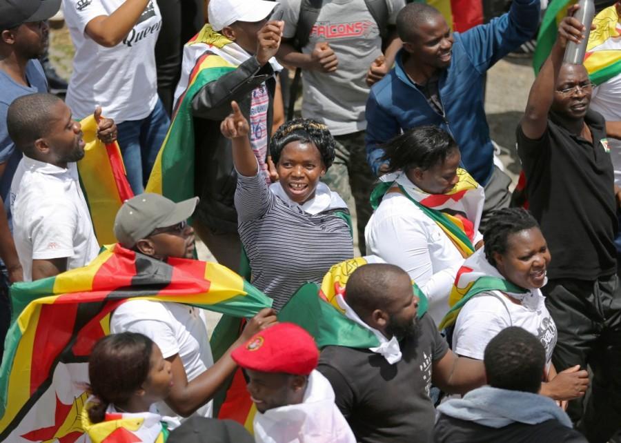 Zimbabwe's ruling party,Robert Mugabe,Zimbabwe's ruling party fires Robert Mugabe,Zimbabwe President Robert Mugabe