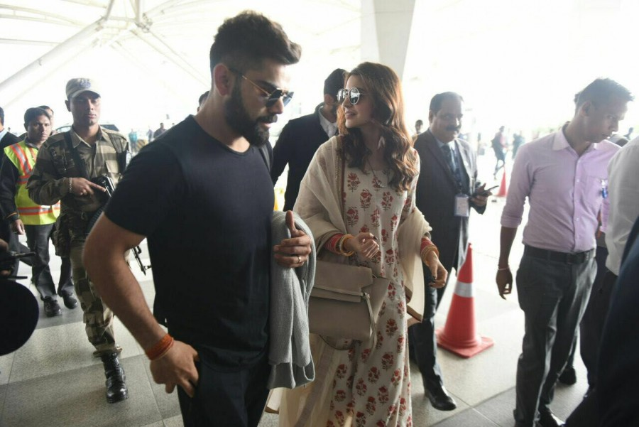 Virat Kohli and Anushka Sharma,Virat Kohli,Anushka Sharma,Virat Kohli at Delhi airport,Anushka Sharma spotted at Delhi airport,Virat Kohli spotted at Delhi airport,Virat Kohli and Anushka Sharma reception,Virat Kohli and Anushka Sharma reception pics,Vira