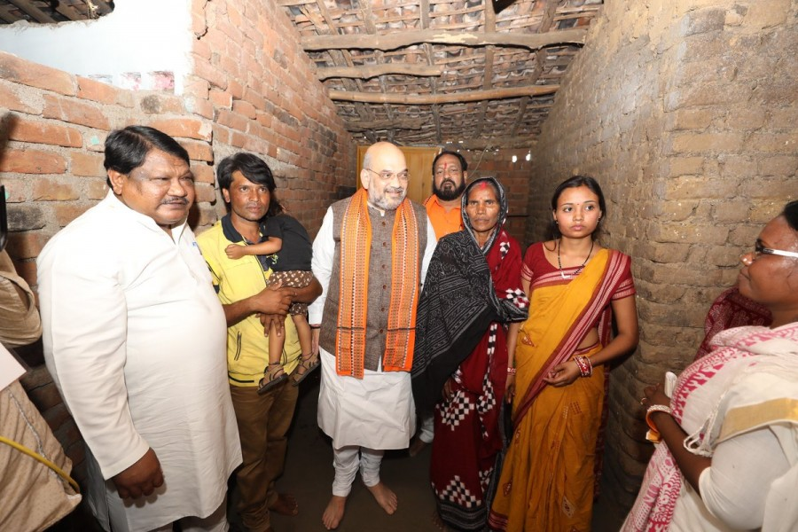 BJP President Amit Shah,Amit Shah,Amit Shah lunch with Dalit family,Dalit family,Dalit family host lunch,Deogaon village,Narendra Modi