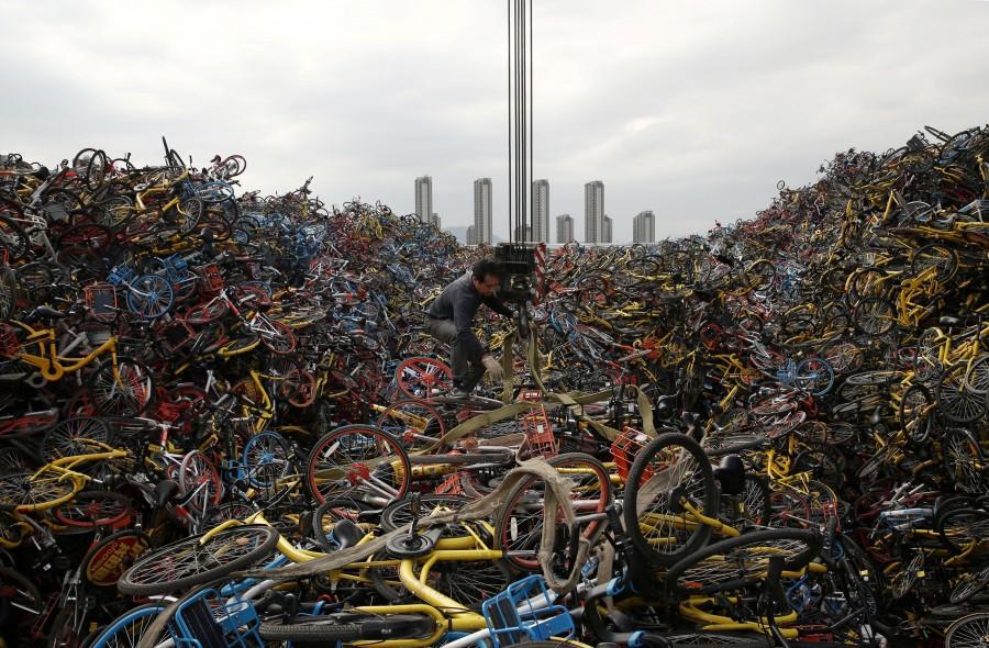 Chinese bike graveyard,bike graveyard,bike graveyard pics,bike graveyard images,bike-sharing graveyards,abandoned bikes