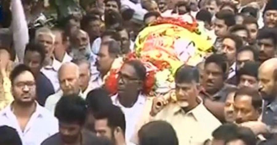 Chief Minister Chandrababu Naidu was seen carrying his body