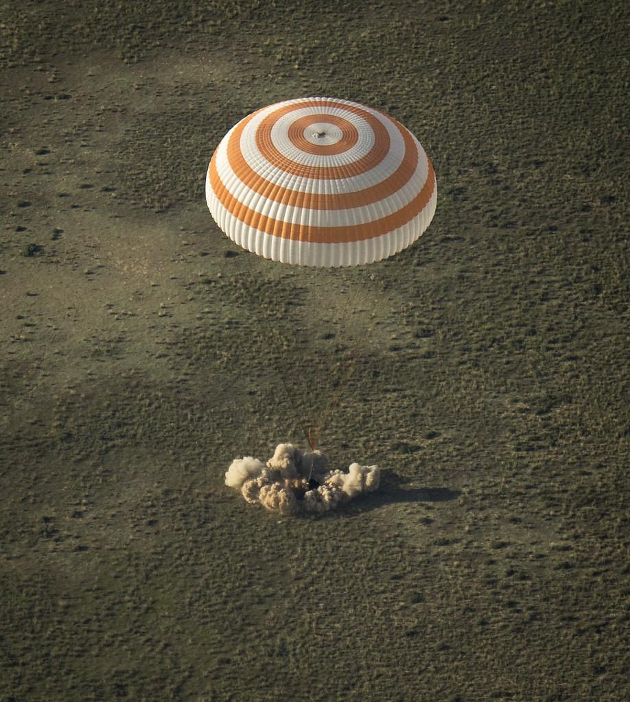The Soyuz TMA-11M spacecraft is seen as it lands with Expedition 39 Commander Koichi Wakata of the Japan Aerospace Exploration Agency (JAXA), Soyuz Commander Mikhail Tyurin of Roscosmos, and Flight Engineer Rick Mastracchio of NASA near the town of Zhezka