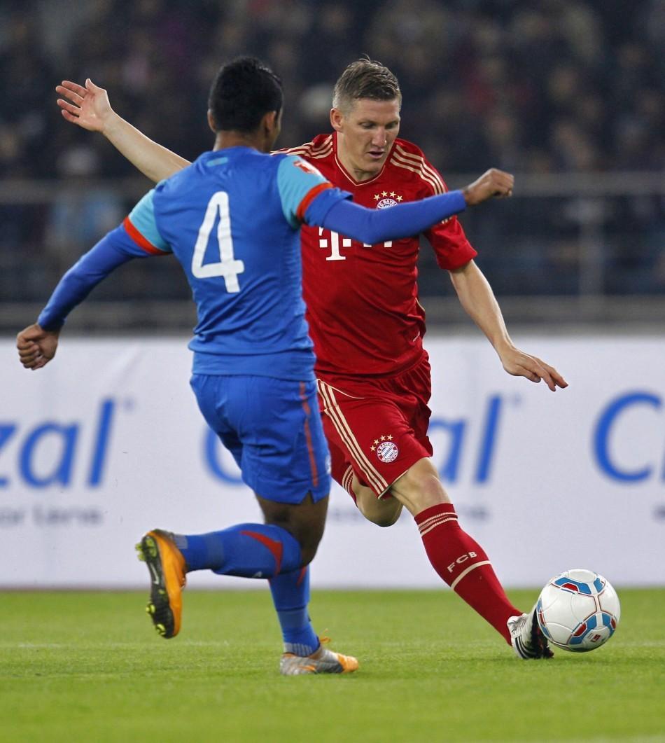 Bastian Schweinsteiger and Nirmal Chettri