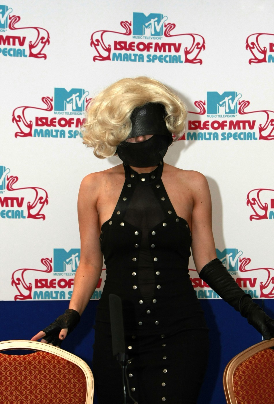 Lady Gaga poses during a news conference before the