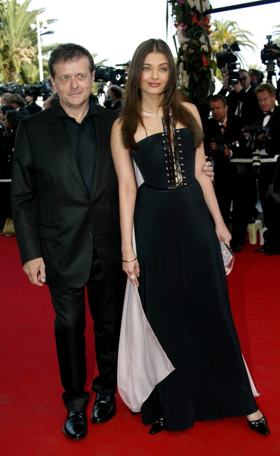 Jury President, French director Patrice Chereau (L), escorts jury member, Indian actress and a former Miss World, Aishwarya Rai (R) during red-carpet arrivals at the 56th International Film Festival in Cannes, May 15, 2003. (Reuters)