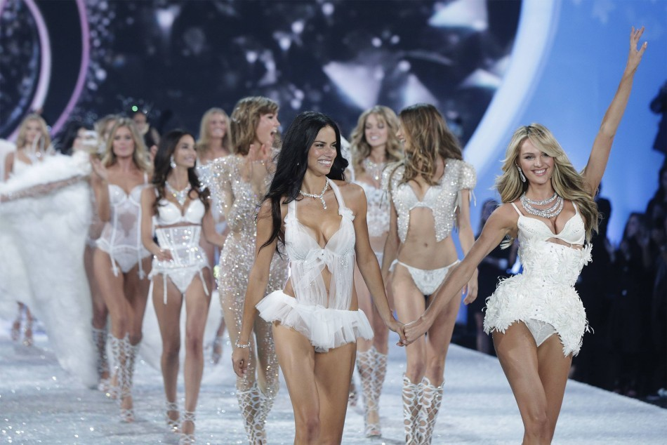 Models Adrianaa Lima and Candice Swanepoel walk out for the finale of the annual Victoria's Secret Fashion Show in New York,
