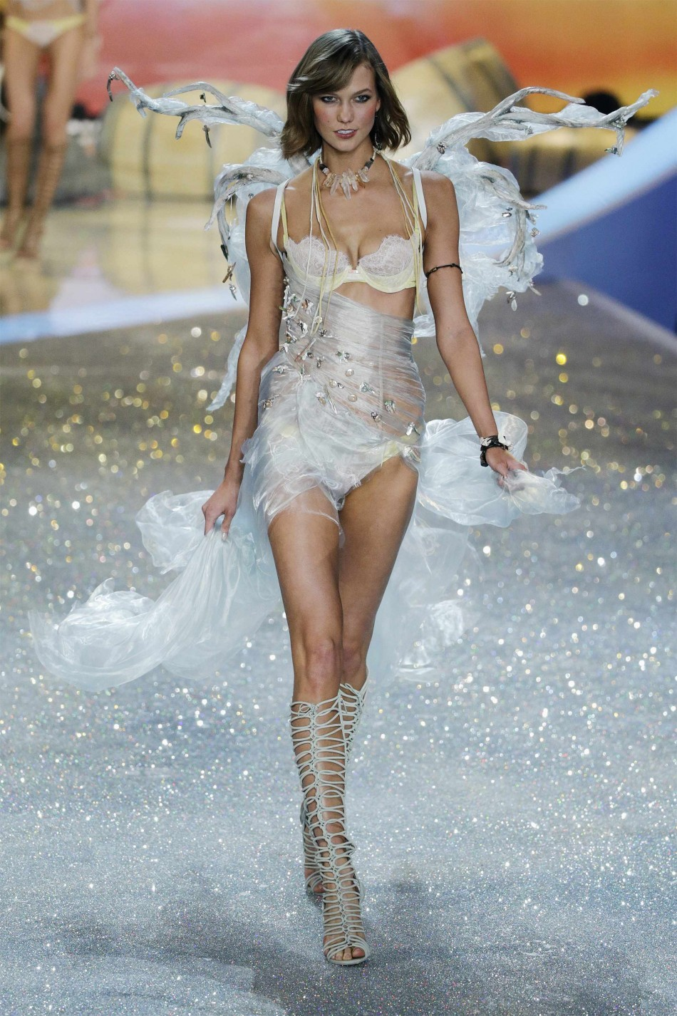 Model Karlie Kloss presents a creation during the annual Victoria's Secret Fashion Show in New York