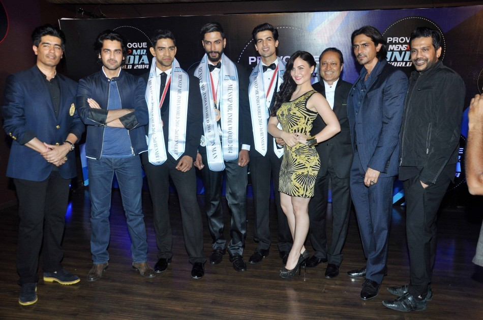 Judges with the winners of the Provogue MensXP Mr. India 2014 in Mumbai