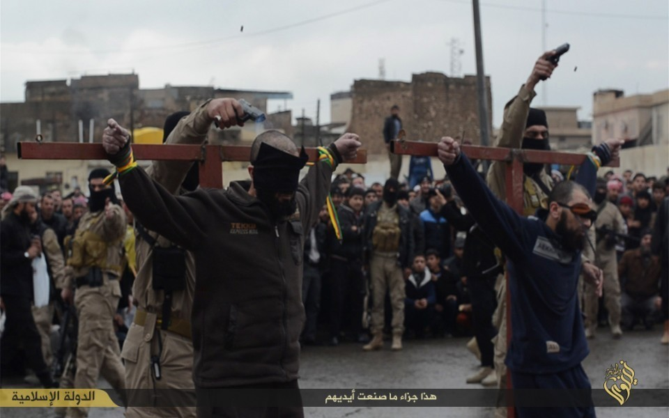 ISIS executions shoot two thieves on point blank range in Mosul.