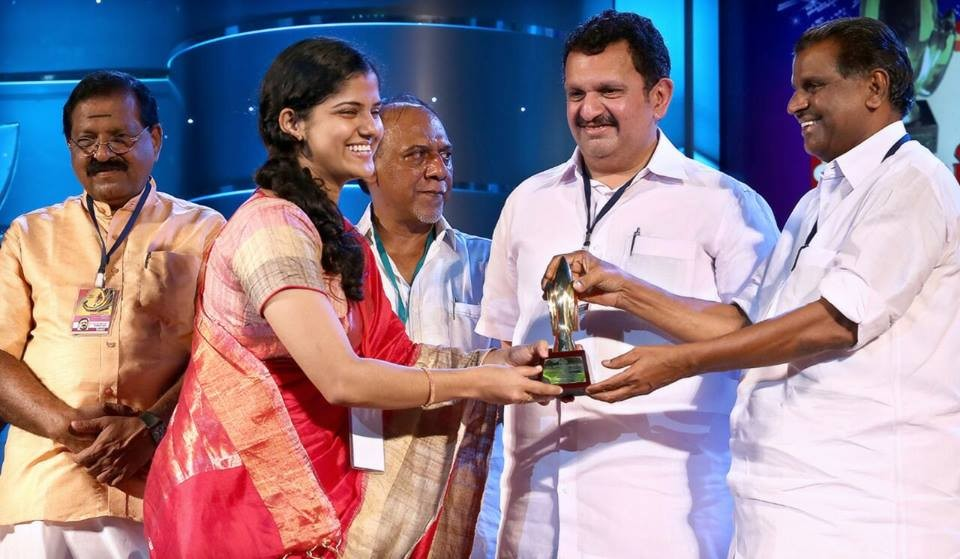 Angel Shijoy receiving the Kerala State TV awards for best dubbing artist