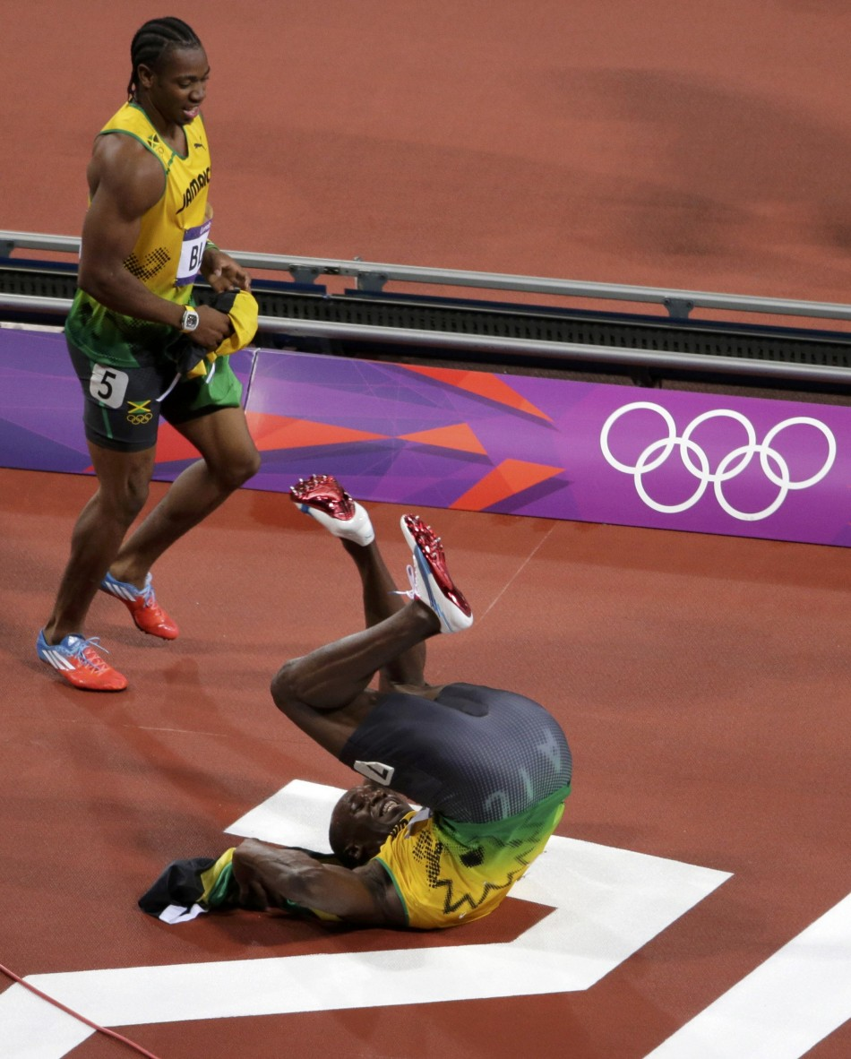 Usain Bolt Defends Olympic Gold; Photos of World's Fastest ...