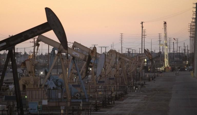 Oil rig pumpjacks, also known as thirsty birds, extract crude from the Wilmington Field oil deposits area where Tidelands Oil Production Company, which is owned by Occidental Petroleum Corporation operates near Long Beach, California in this July 30, 2013