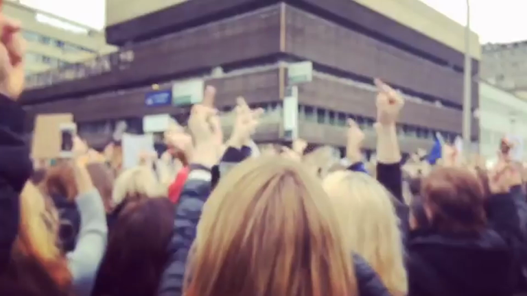 Protesters raise middle finger in demo against Polish abortion ban