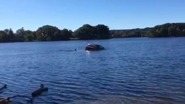 Good Samaritans rescue drowning woman from her sinking SUV