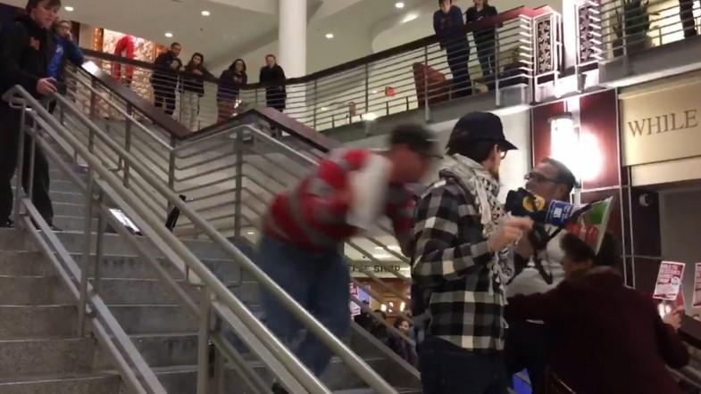 Anti-Trump protester floored whilst speaking at Ohio rally