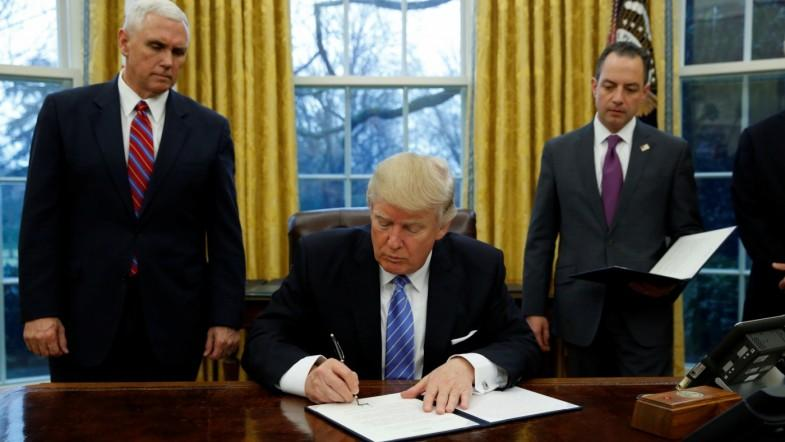 President Donald Trump signs executive order withdrawing US from TPP trade deal