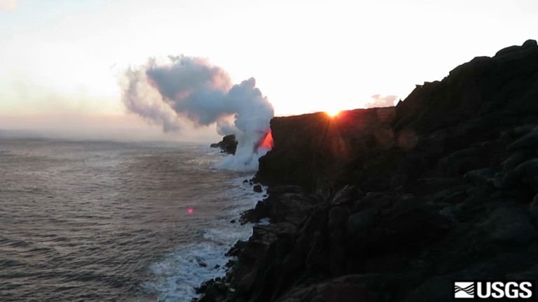Watch spectacular stream of lava from Hawaii's Kilauea volcano flow into the sea