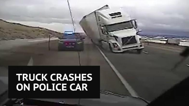 Wind blows truck onto Wyoming Highway Patrol Vehicle