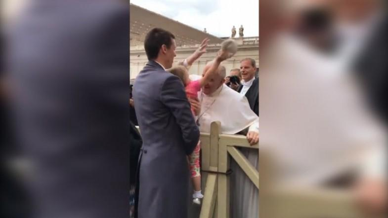 Little girl sneakily steals Popes hat while going in for a kiss